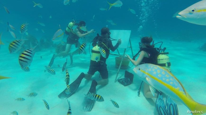 Cuban Artist Sketches Under Sea Among Fish, Coral Reefs